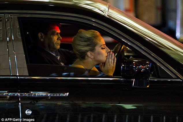 Lady Gaga mourns the election result from within her Rolls Royce after staging a protest outside Trump Tower in New York
