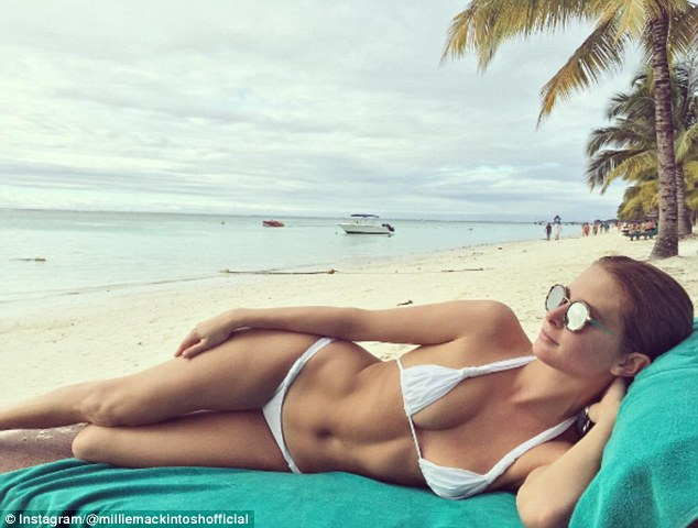 'How I would like to spend every Saturday':Millie Mackintosh, 27, showed off her abs in a tiny white bikini during an exotic Mauritius break