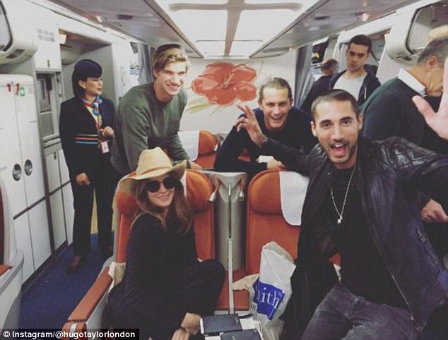 Flight squad:Smiling for the lens, the couple posed alongside supermodel Rosie Huntington-Whiteley's model brother Toby