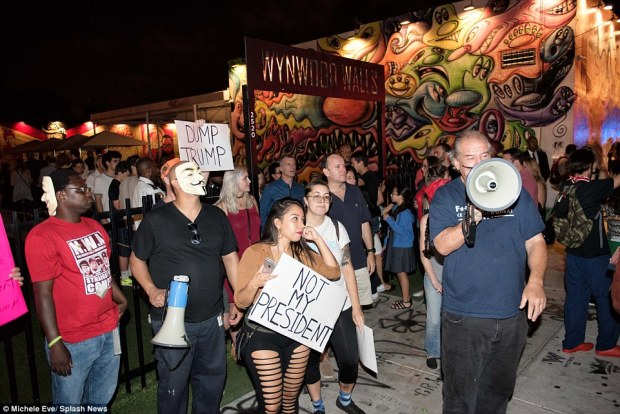 Protestors attend a rally in Wynwood, Miami to protest against President-elect Donald Trump in Florida on Saturday night
