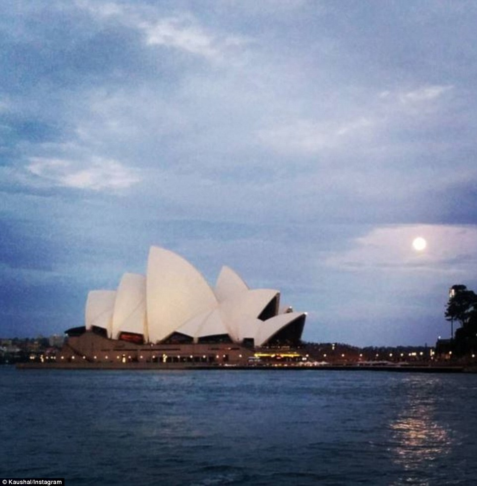 The supermoon captured by a photographer as it shines brightly through cloud cover on Monday