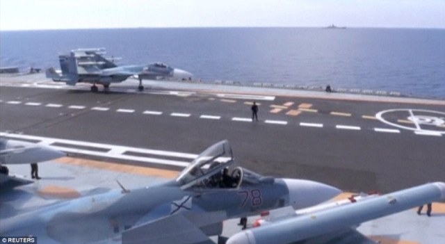 Current U.S. policy is to strike against Isis while supporting moderate rebels opposed to Assad. But Donald Trump has very different ideas. Pictured, Russian aircraft on the Admiral Kuznetsov
