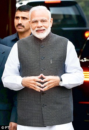 Prime Minister Narendra Modi arrives to address the media on the opening day of the winter session of Parliament in New Delhi