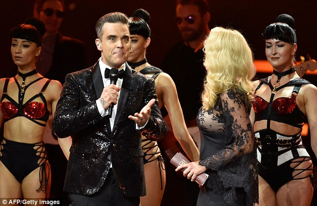 Robbie Williams Sticks His Head In Presenters Cleavage At