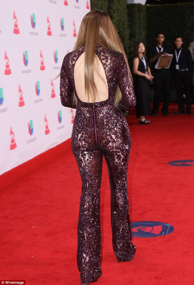 Trademark! JLo put her bountiful booty on full display in the curve hugging garment