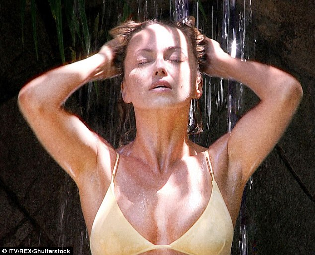 Soaked:Amid reports the jungle shower is actually manually operated, the professional dancer didn't seem to mind the conditions as she leant back and soaked herself