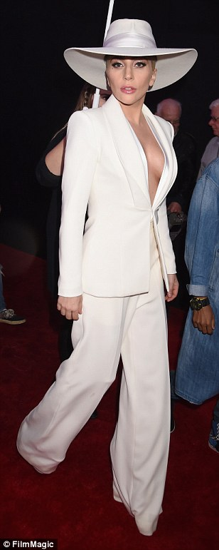 Taking the plunge: Lady Gaga went for a surprisingly understated look in a white wide-legged suit and hat
