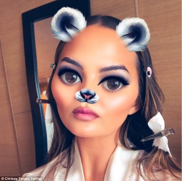 Having some fun:The beautiful brunette shared a photo while getting ready for the awards show using a Snapchat filter that digitally added furry ears and a nose to her face
