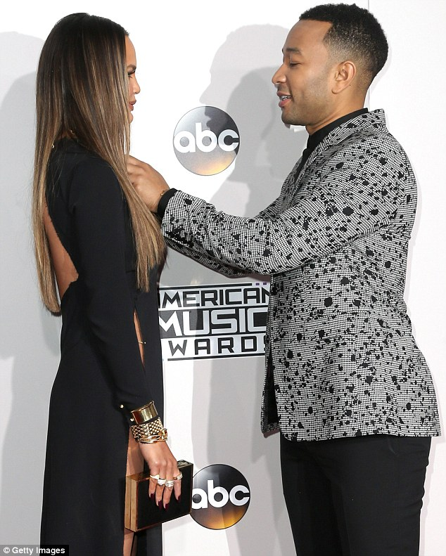 Risque: The former Sports Illustrated Swimsuit issue cover girl carried a structured clutch in her hand while posing on the carpet with her husband John Legend
