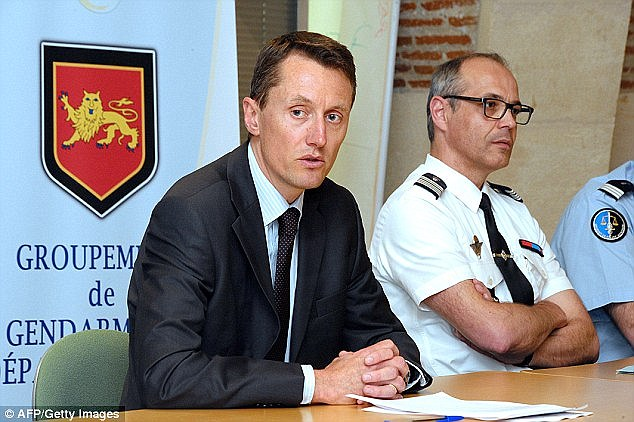 Prosecutor Pascal Prache (left) speaks during a press conference in Agen, in April last year, where it was revealed body parts believed to be that of missing Violent Price had been found in two separate locations
