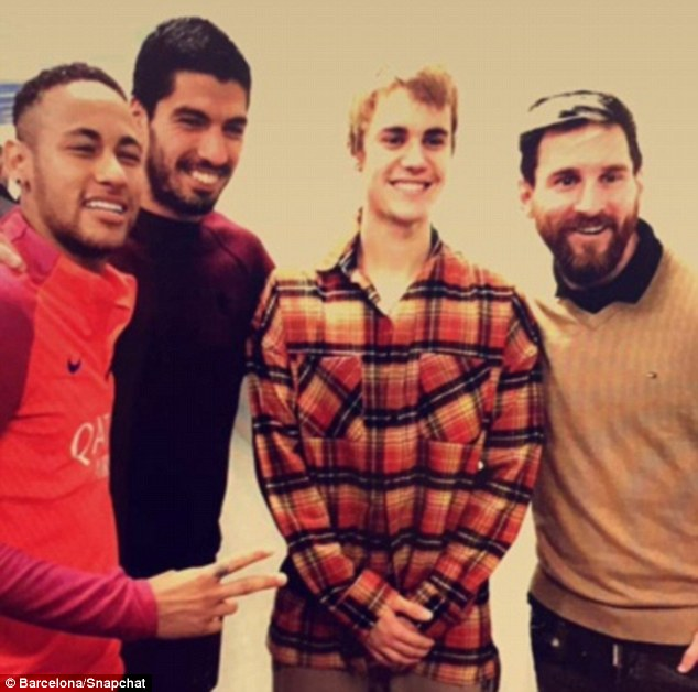 (Left-right) Neymar, Luis Suarez, Justin Bieber and Lionel Messi pose for a picture on Monday