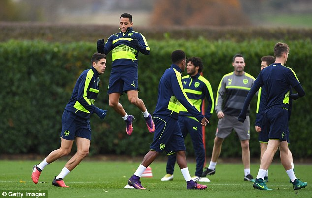 Sanchez (2nd left) leaps into the air during an exercise drill with his team-mates