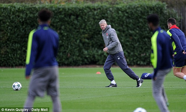 Wenger's (centre) team can guarantee they finish top of their group with a victory