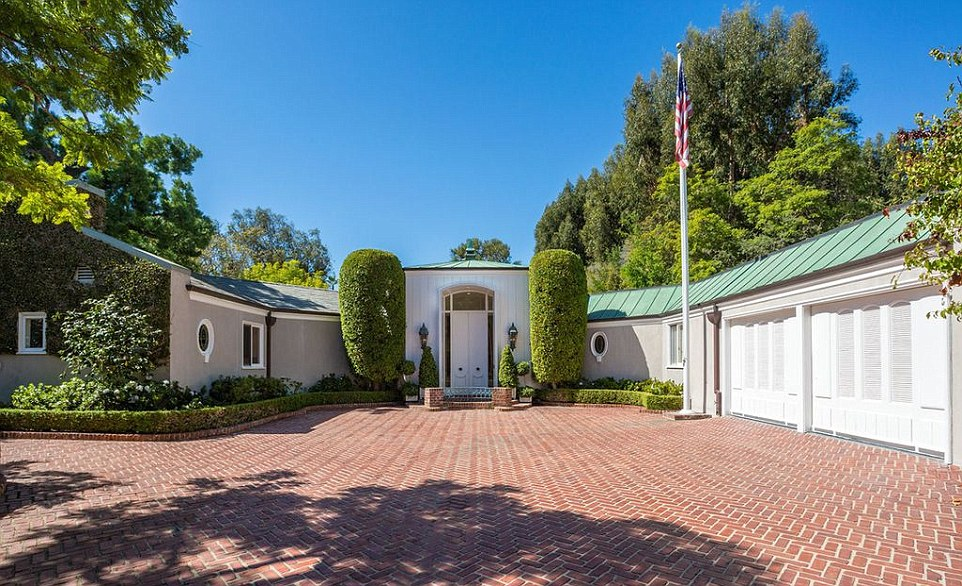 The front entrance of the new property bought by Ms Collins for $12.4million, more than $4million over the asking price