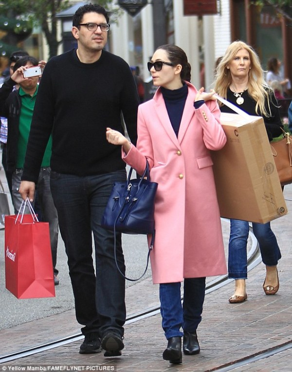 Emmy Rossum stands out in pink coat as she and fiance Sam ...