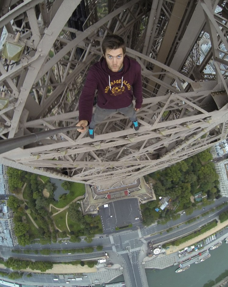 Image result for man climbing eiffel tower