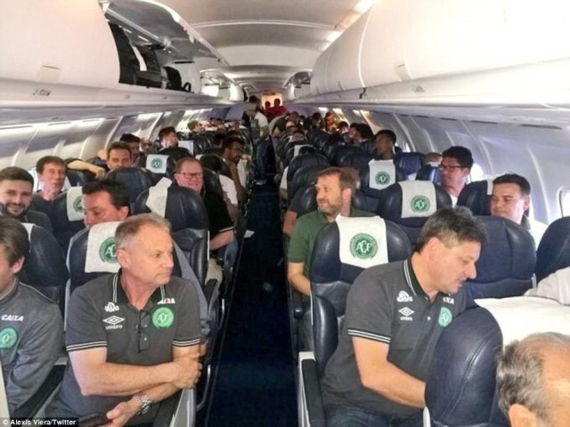 The Chapecoense football team are pictured here on a plane.The footballers had to change their flight and board the plane that crashed after Brazilian aviation authorities prevented them from taking a charter flight, it has been claimed