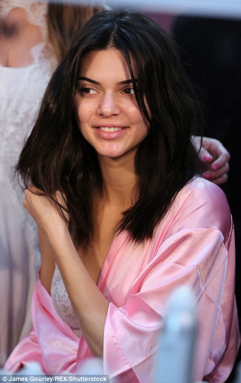 Fluffing it up: Kendall seemed focused on her hair rather than her make-up