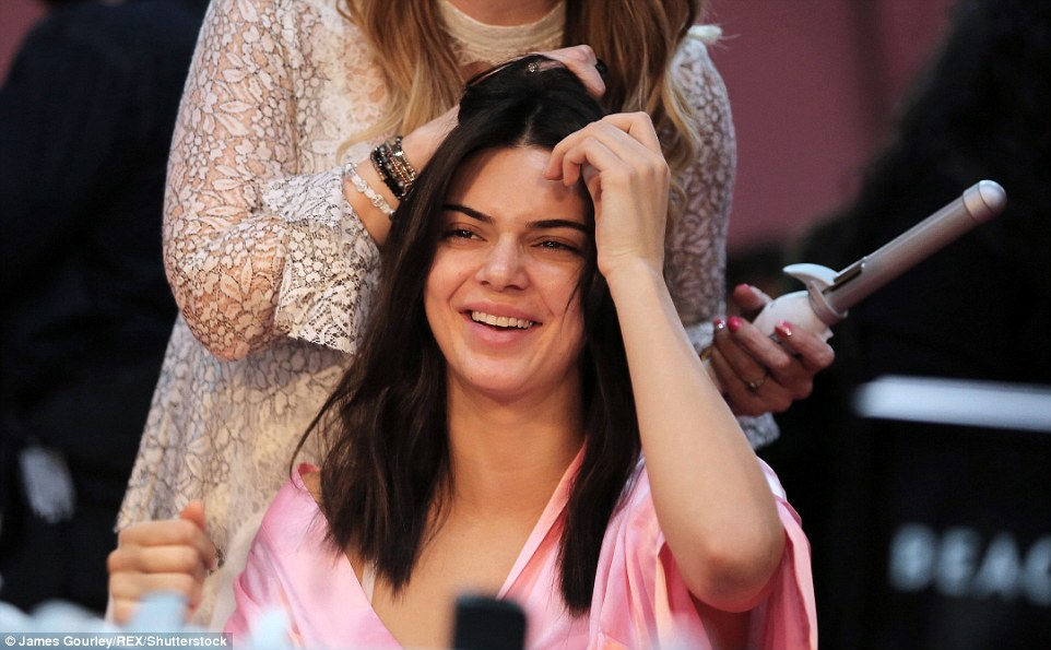 Having a giggle: Joining the backstage beauties was fellow member of the 'Instagram' supermodels, Kendall Jenner, who looked fresh-faced as she went make-up free