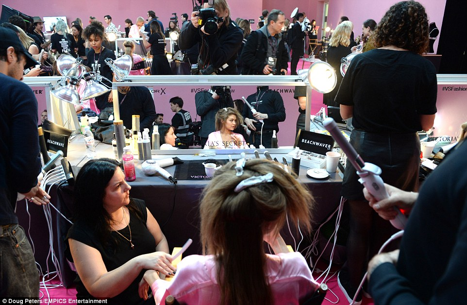 All eyes on me: Gigi looked distracted as she underwent her pamper session