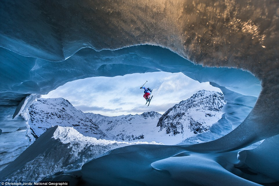 Pitztal Galcier, Austria: A skier takes flight above an ice cave nearly 10,000 feet high in the Alps