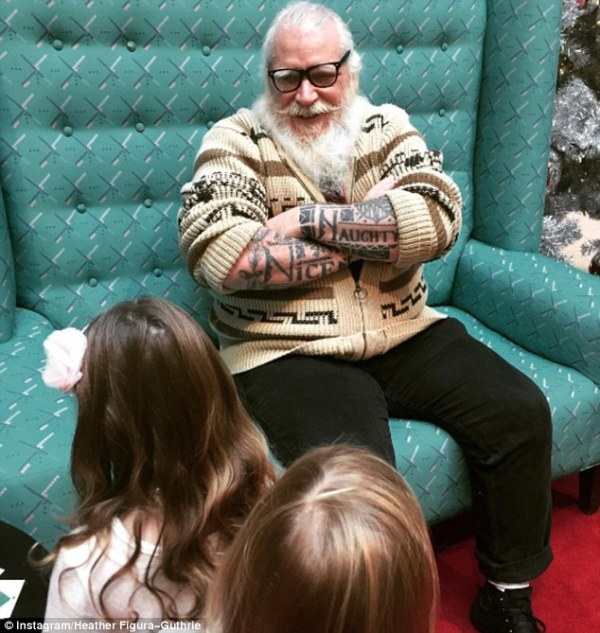 Hipster Santa, complete with piercings and tattoos ...