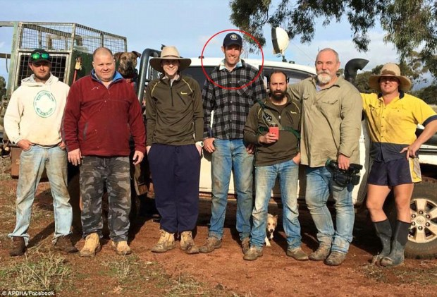 Greig Tonkins (circled, middle) has been revealed as the man who punched a kangaroo while on a hunting trip in rural New South Wales in an effort to save his pet dog from its attack