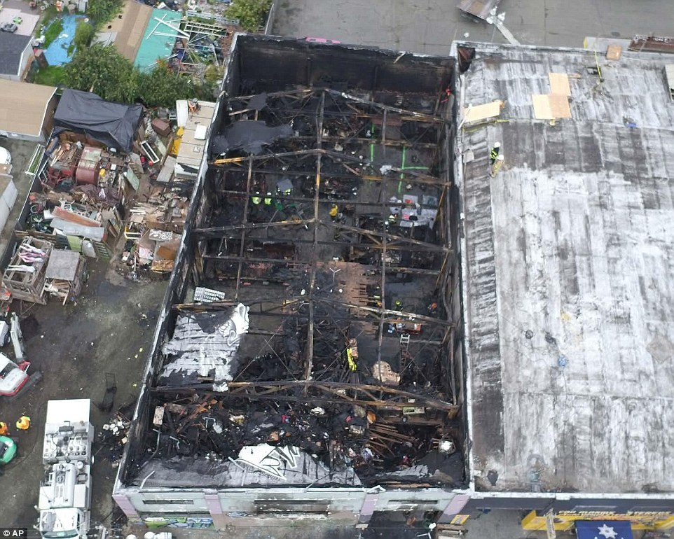 Carnage: The aftermath of the fire in which the official death toll has reached 36, with warnings it may well increase further