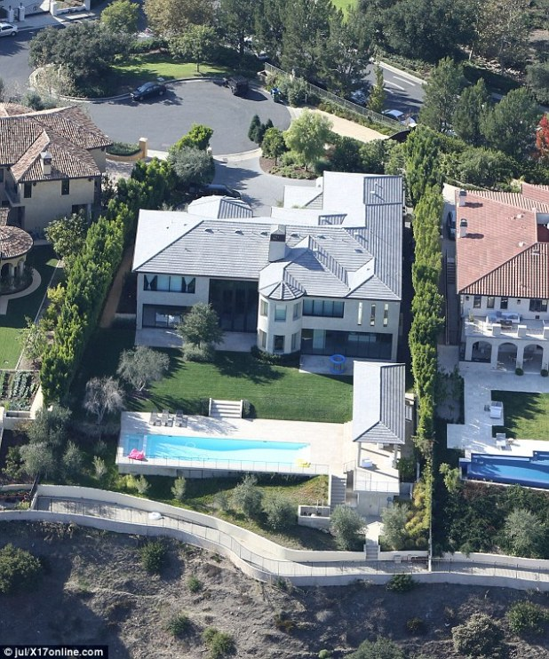 He doesn't reside here:The site also stands by its earlier claim that West is not living with Kardashian inside their Bel-Air mansion. Rather, the Yeezy singer has been residing in an LA-area rental as an outpatient