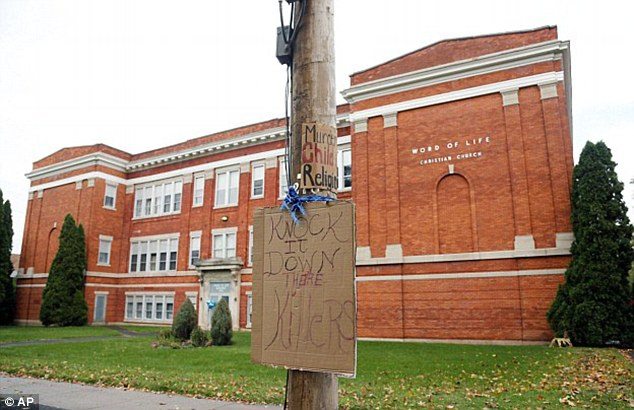 A file photo shows a sign hanging on a utility pole outside the Word of Life Christian Church in New Hartford, New York in 2015 where the horrific incident took place