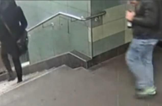 CCTV shows the young woman walking through the metro station in Berlin when the man comes up behind her, holding a beer in one hand and a cigarette in the other