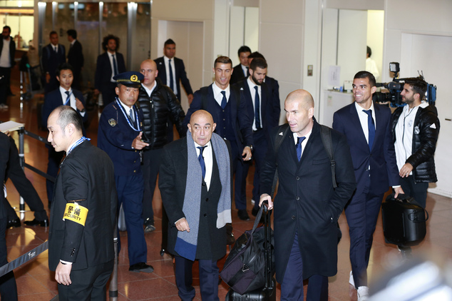 Real Madrid's head coach Zinedine Zidane and his team members arrival at Haneda International Airport in Tokyo, Monday, Dec. 12, 2016. Real Madrid are flying...