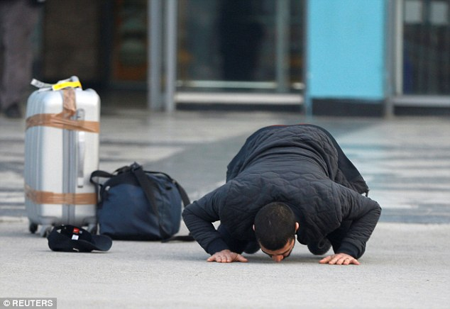Another Afghan kisses the ground in joy after returning to his home country. MailOnline is not suggesting he is one of those convicted of a crime