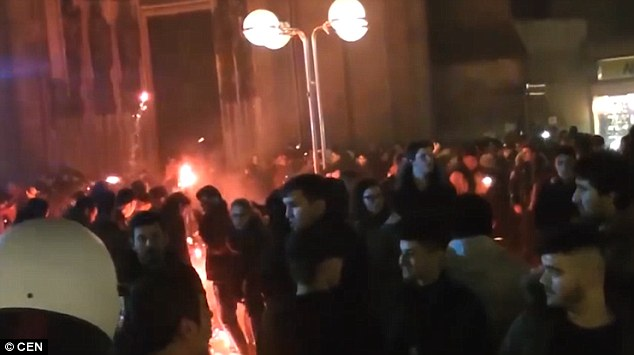 It also shows fireworks being repeatedly fired into groups of people with many of them exploding at the feet of the police officers trying to control the 2,000-strong crowd