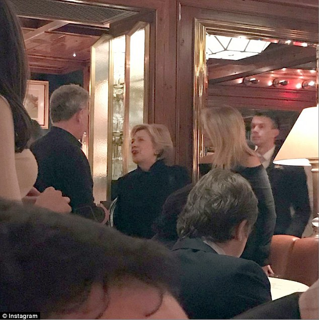 Get used to this life: Hillary Clinton will not score an upset in the electoral college. She spent Wednesday night at one of New York's most difficult to get into restaurants chatting to Christie Brinkley (right)