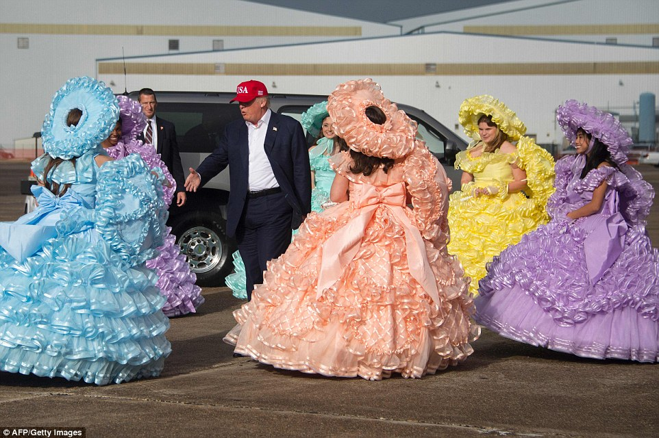 Donald Trump was greeted by the Azalea Trail Maids as he stepped off the plane in Alabama  on Saturday afternoon