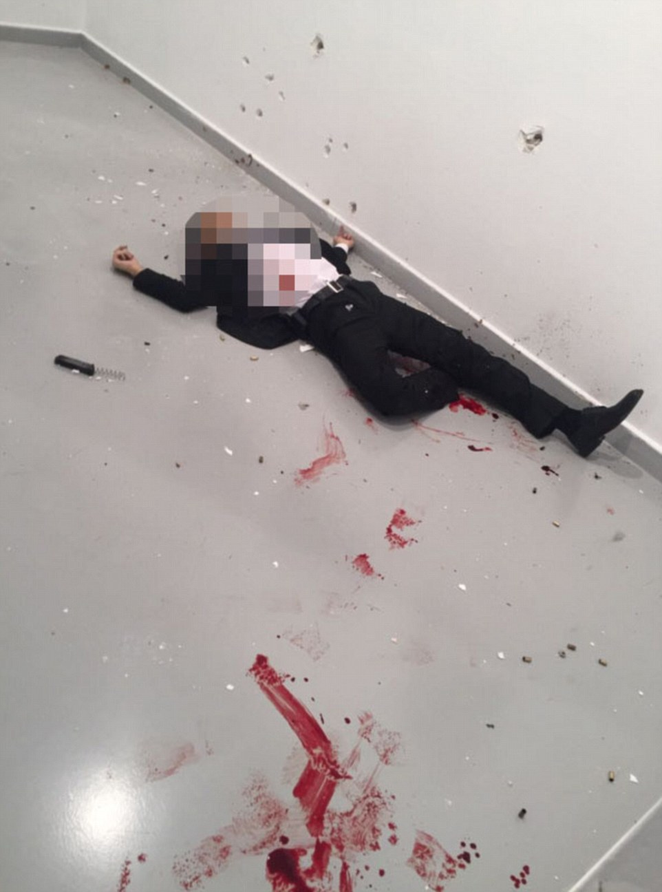 An image of the gunman, lying dead on the floor of the art gallery, was posted on Twitter