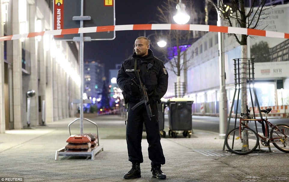 Armed police are standing guard at the entrance to the market and around Berlin as security is tightened