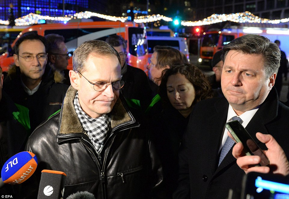 Berlin's Mayor Michael Mueller speaks to the media at the scene of the crash as officials and police launched an investigation