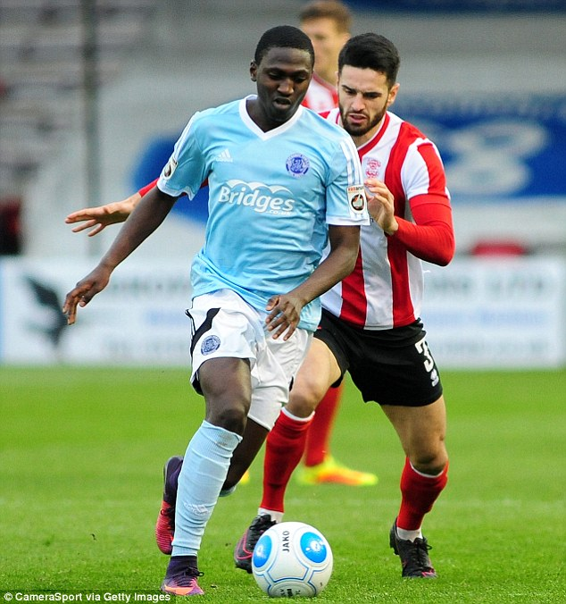 Manchester City and Leicester have checked up on Aldershot Town striker Idris Kanu (left)