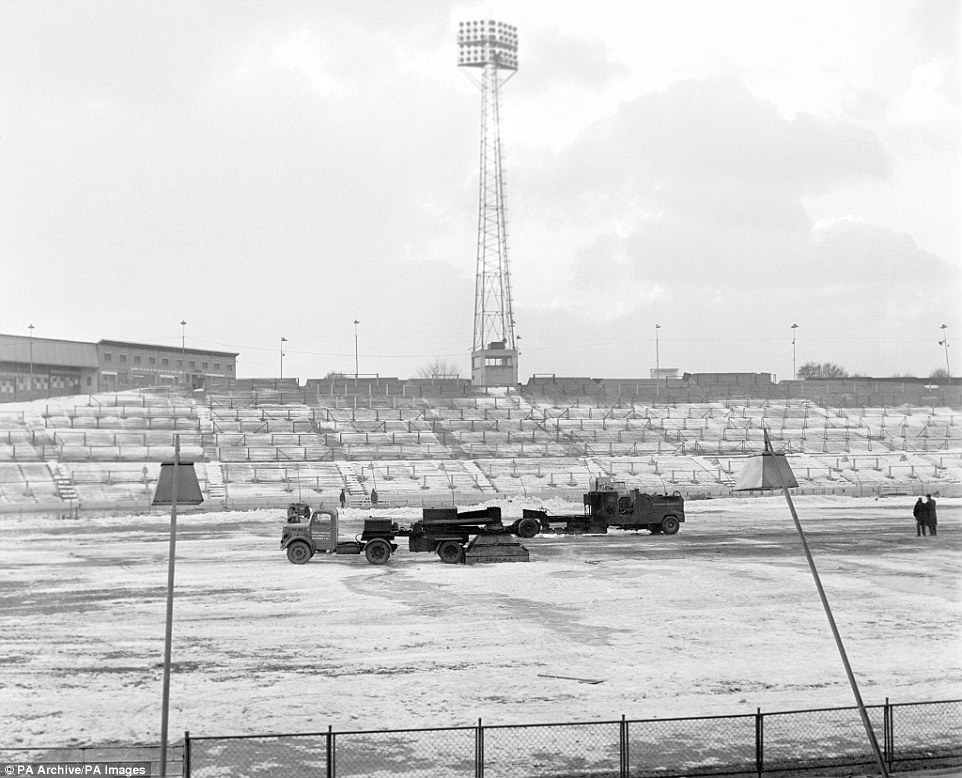 Road-burners, conventionally used to melt tar, are employed to thaw out the frozen Stamford Bridge pitch