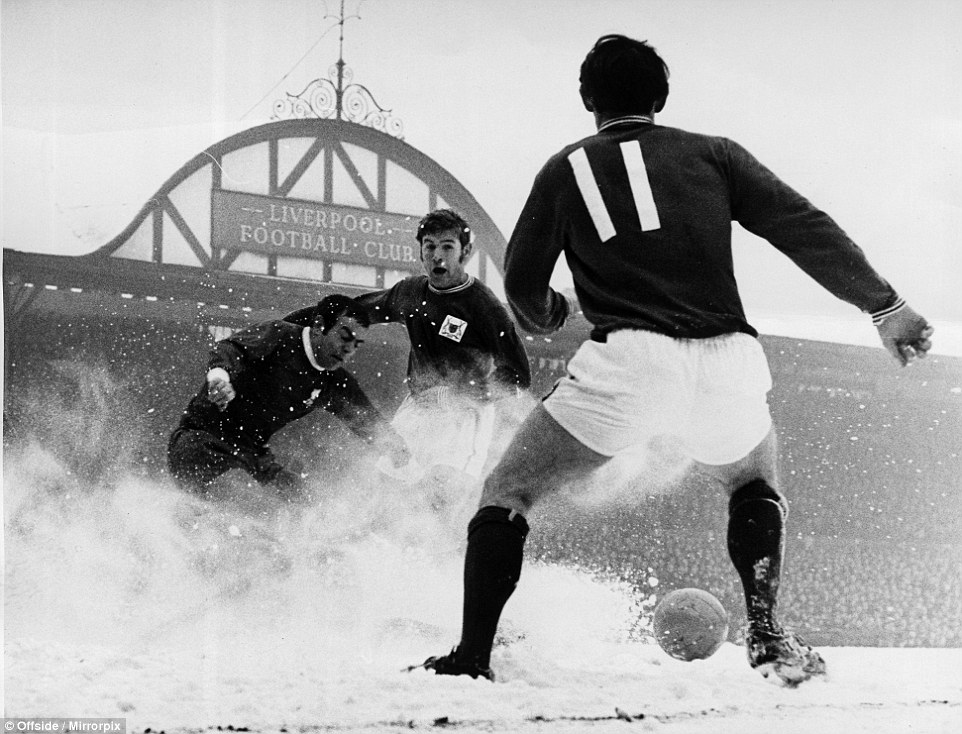 Liverpool v Nottingham Forest on 15th February 1969: Ian St. John clears the ball but instead kicks it into a flurry of snow