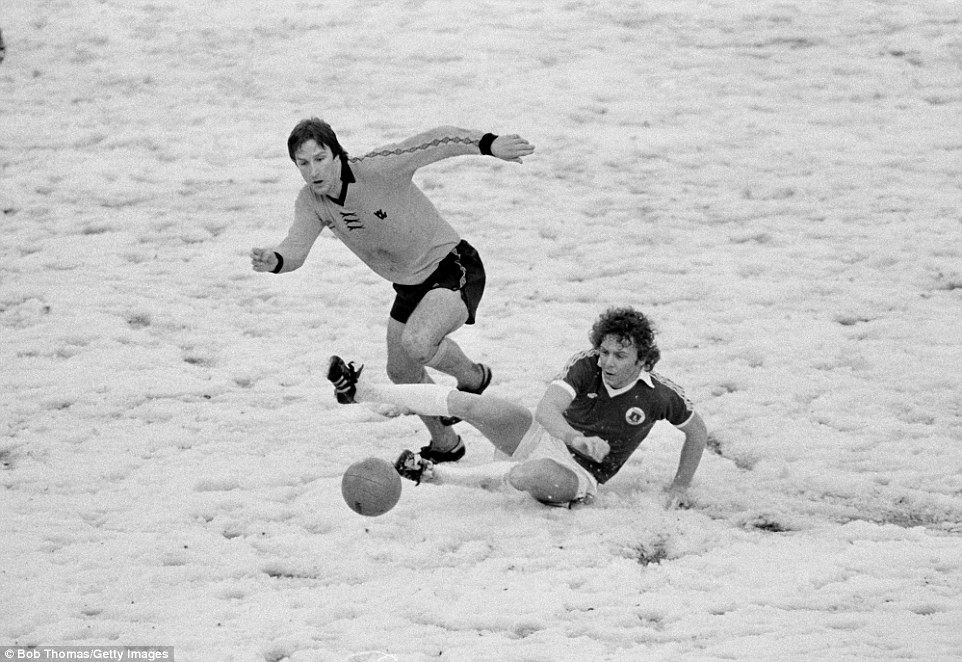 Everton star Andy King slides in to tackle Steve Daley during a First Division match against Wolves played on a snow in 1979