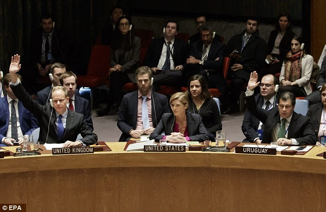 Orders: US ambassador Samantha Power (center) was ordered to abstain from voting by Obama, but the White House says Egypt organized the resolution with Palestinians