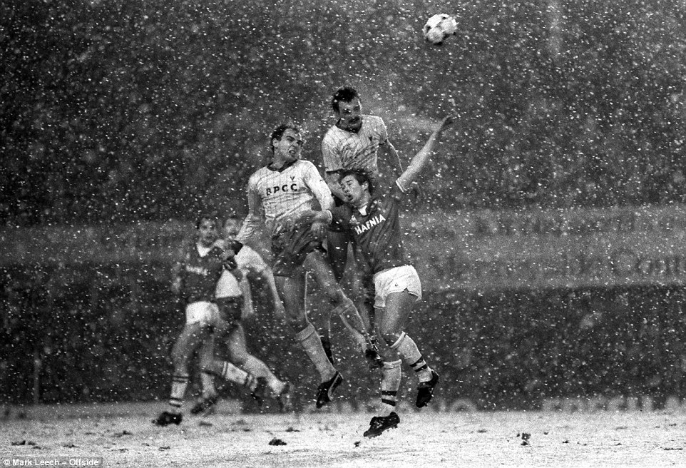 Everton v Oxford: Paul Hinshelwood and Gary Briggs outjump Everton striker Adrian Heath in the snow at Goodison Park