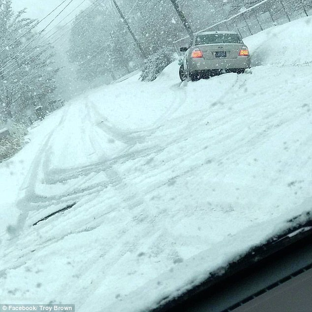 took a picture of a stranded vehicle in the snow and posted it on Facebook with the caption: 'I was going to help her but she has a #Trump sticker on her car #CallYoPresident'
