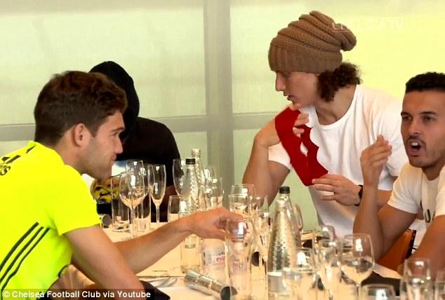 David Luiz sat alongside fellow Brazilian Willian and Pedro during last weekend's festive lunch