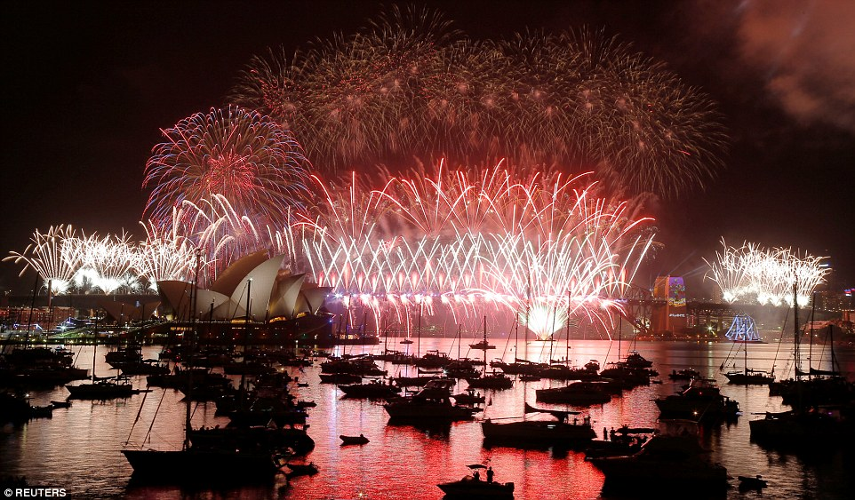 Fireworks pour over the Harbour Bridge as Australia ushers in the New Year in Sydney