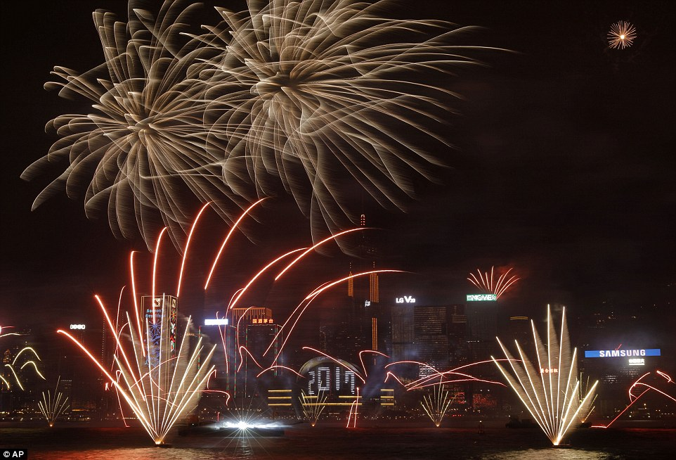 Fireworks explode over Victoria Harbour to celebrate the New Year's Eve in Hong Kong