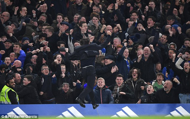 Conte turns to celebrate in front of the home supporters after Willian's second goal
